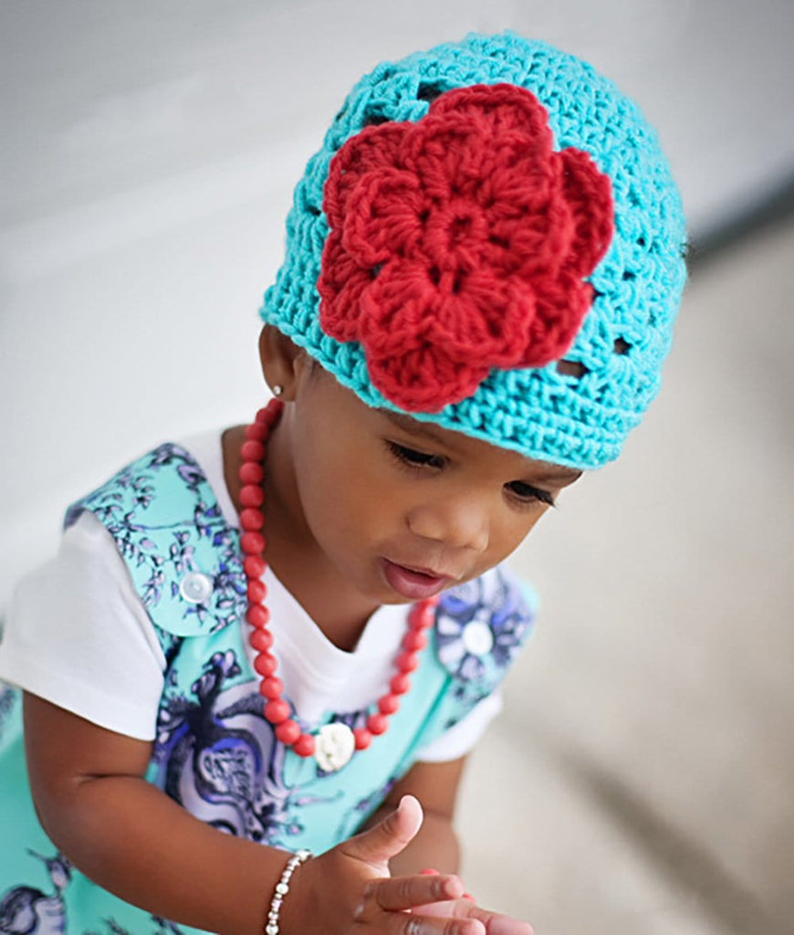 turquoise crochet baby girl beanie hat with burnt orange flower accent