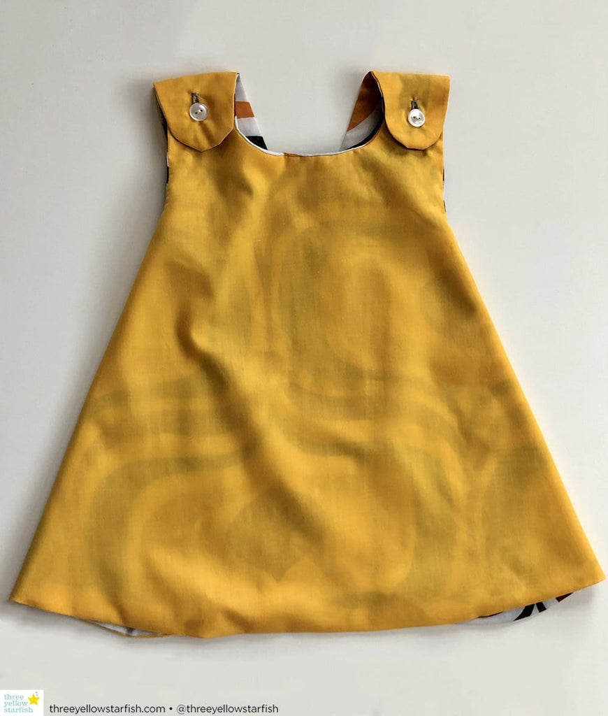 vintage baby girls dress in yellow