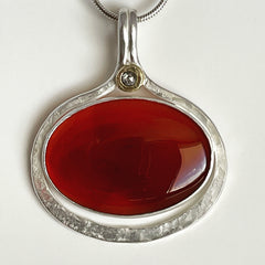 large carnelian pendant with silver and gold
