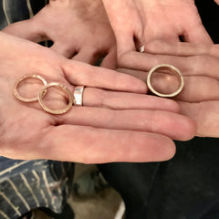 two hands holding wedding bands