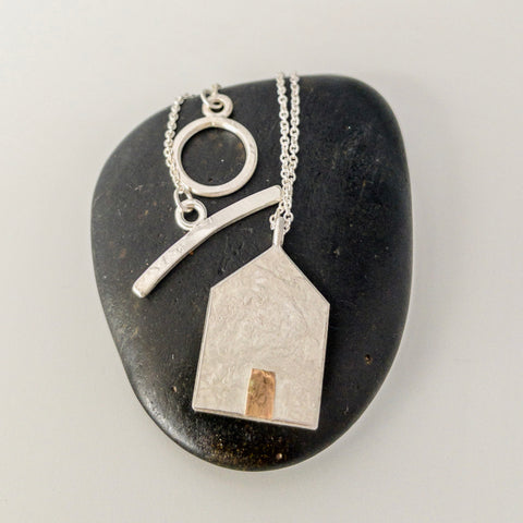 House pendant with gold door
