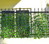 Bamboo garden fence with a medium sized vegetable garden