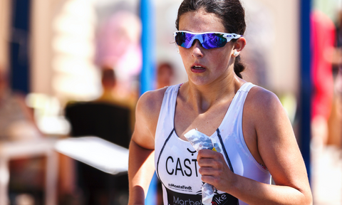 a female runner in the midst of a marathon