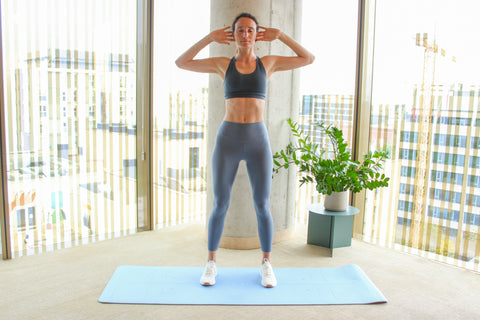 woman in the starting position for standing oblique crunch