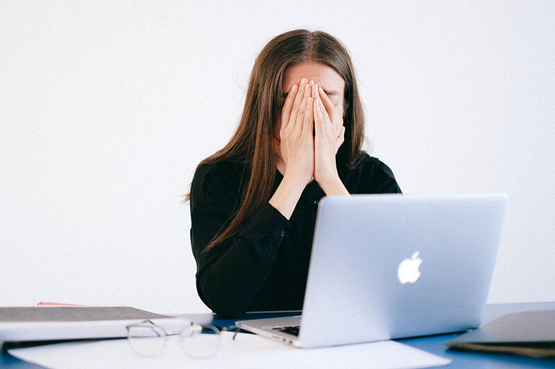 Frustrated woman experiencing stress which impacts your skin