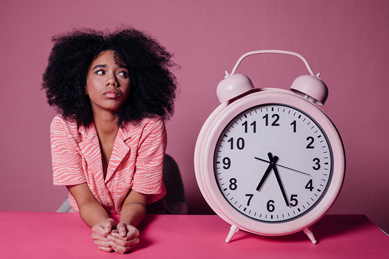 Woman waiting for anti-blemish products to work