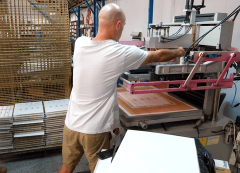 Image showing Pete making final adjustments to the ATMA automatic screen printer