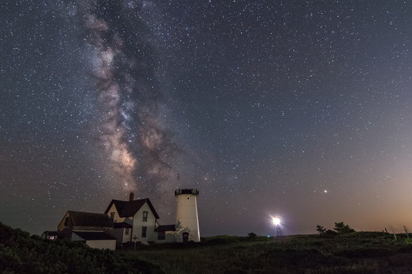 The Milky Way core rising over Stage Neck Light in Chatham, Massachusetts