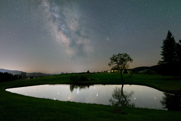 A small pond with the Milky Way core in the backgound