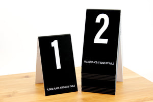 Tall black table numbers in number sequence 1-20. Our tall table numbers are ideal for any food service environment. Please place at edge of table is printed on the bottom of each number. www.citygrafx.com.