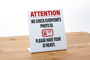 We Check Photo ID Counter Signs are perfect for use in retail, lottery, grocery and business environments.. Visit us at www.citygrafx.com.