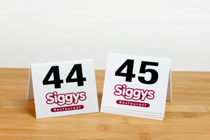 Custom printed table numbers. Perfect for the food service industry. Visit us at www.citygrafx.com.