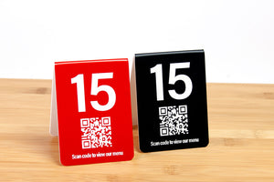 Engraved table numbers with a QR code are perfect for use in restaurants and the food service industry. QR codes are ideal for linking to menus or services offered. www.citygrafx.com