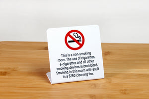 No smoking signs for hotel guest rooms. Signs are ideal for use in hotel rooms and event venues. Sign cover the use of cigarettes, e-cigarettes and all other smoking devices. www.citygrafx.com.
