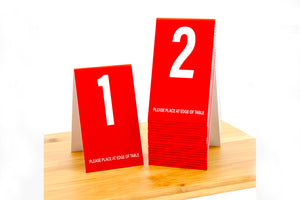 Tall red table numbers. www.citygrafx.com.