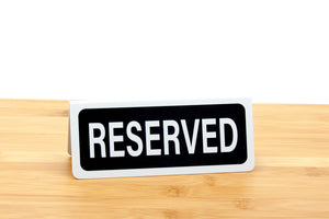 Small reserved signs for restaurants and caterings.