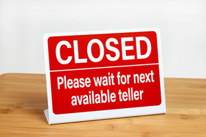 Bank teller signs are perfect for use in financial environments. These L style bank teller signs let customers know to wait for the next available teller. www.citygrafx.com