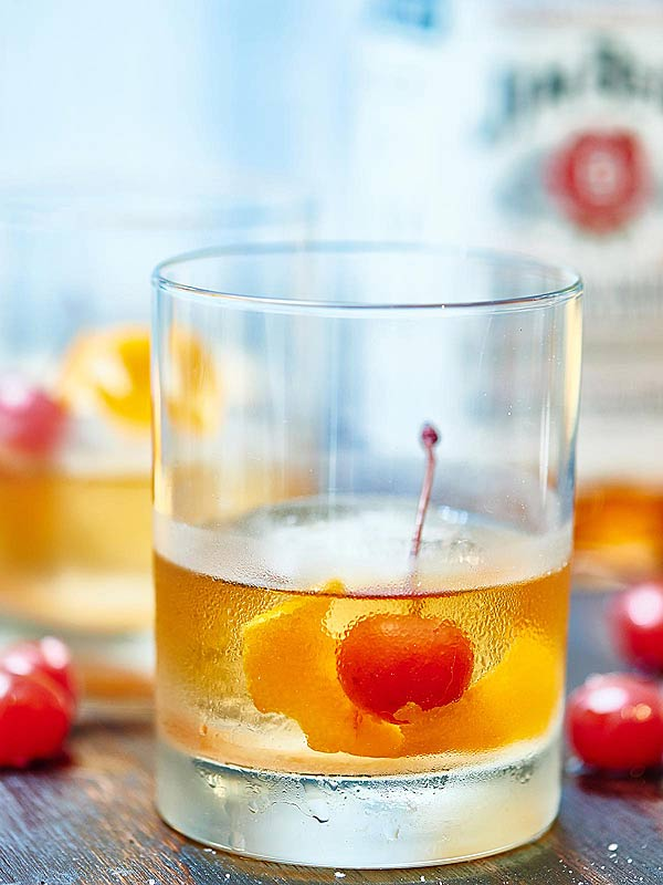 Whiskey with old fashioned ice ball press cocktail recipe with Pressice Barware ice ball press
