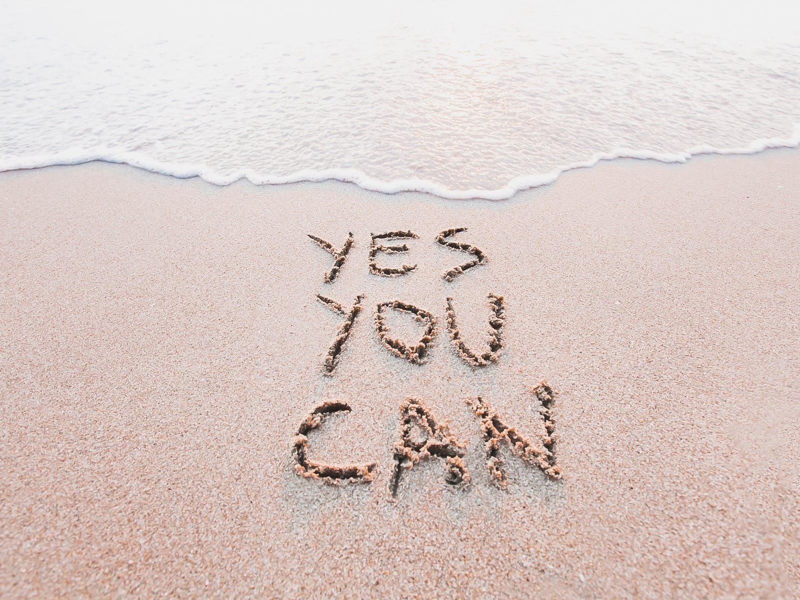 Yes You Can written in the sand at the beach   Metanoia Wellness