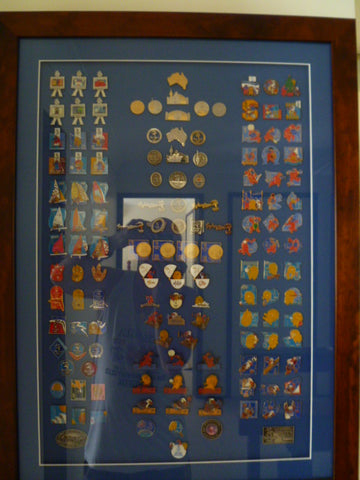 framed lot of all the olympic badges done by the major firm
