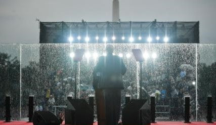 President Trump looking at his audience in the rain
