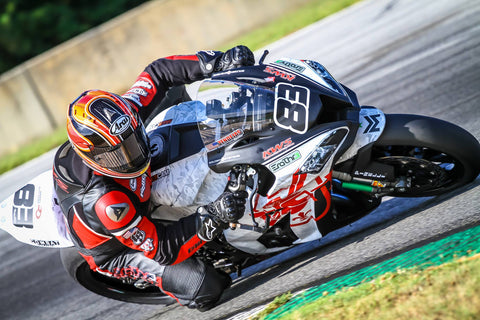 Luie Zendejas drags a knee aboard his Kawasaki ZX-10R Superbike