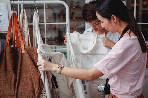 2 Women looking at some clothes