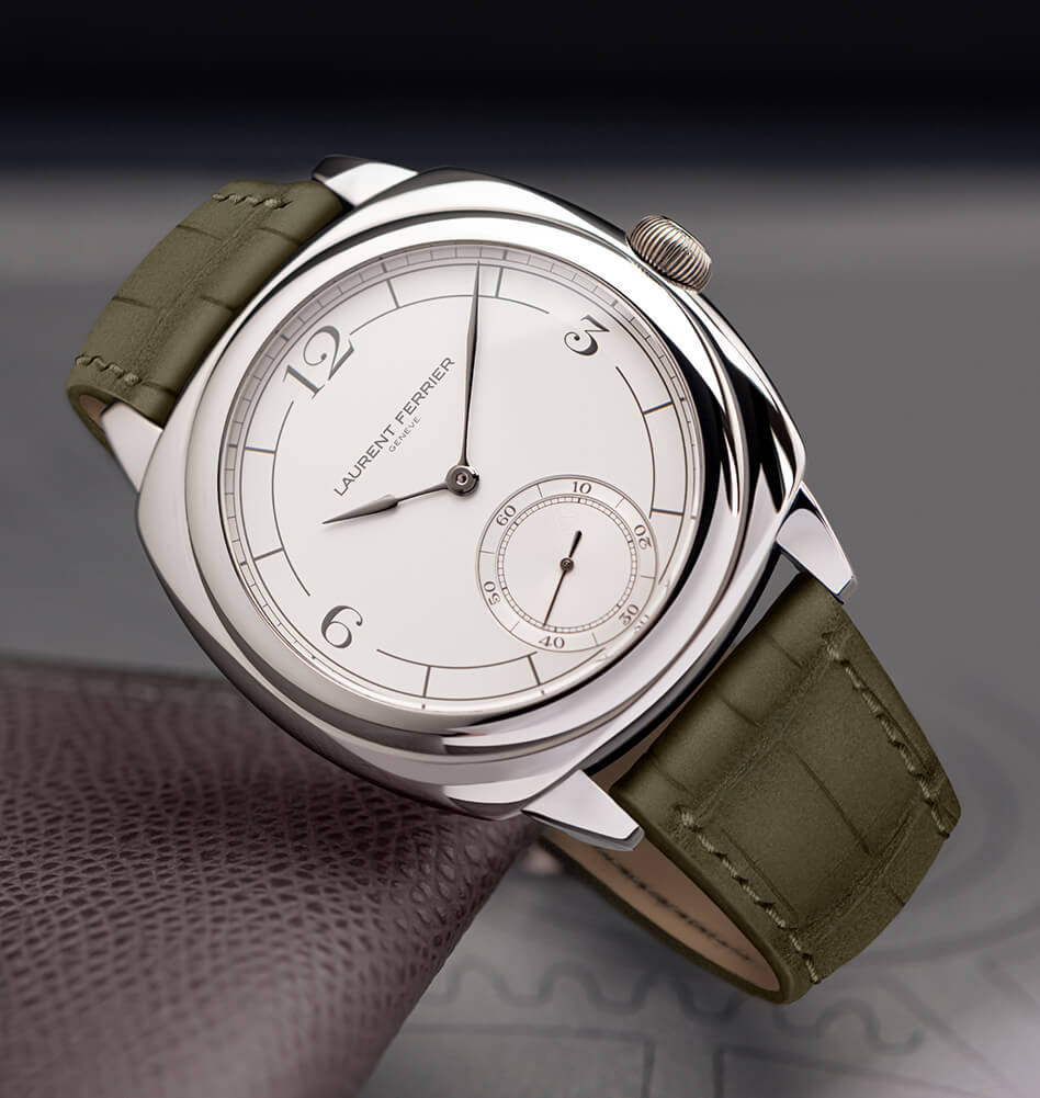 Light version of the watch seen from the front exhibiting dial details and matte soft khaki bracelet