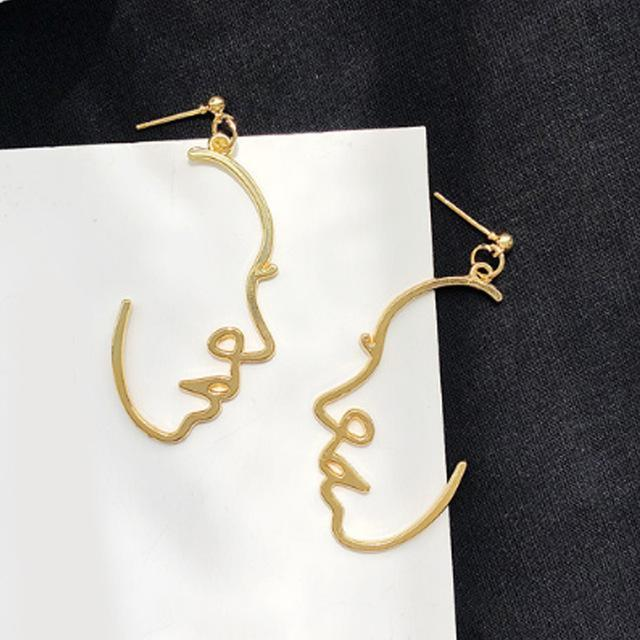 Faces shaped drop earrings - Fashion Bug Online