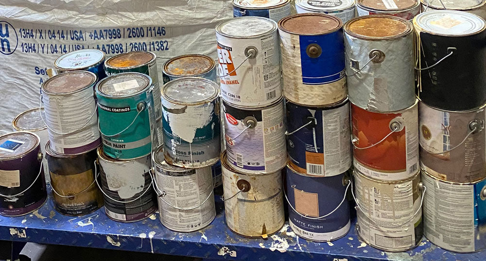 Close up of used paint cans