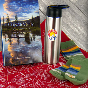 Colorado land we love bundle with a colorado outdoors theme book, bandana, water bottle, and Rocky Mountain National Park socks
