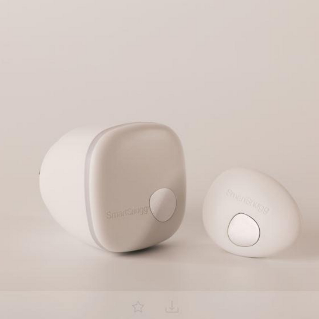 SmartSnugg SmartPebble the low-energy Bluetooth transmitter of your child's internal sleeper temperature and sleeping position. Blush, White, Sage and Sky. Available from SNOOZE www.shopsnooze.co.nz