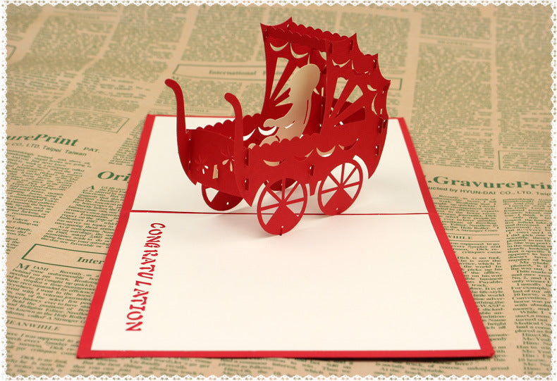 new baby pop up card in red