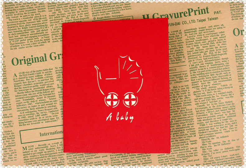 new baby pop up card in red - front cover