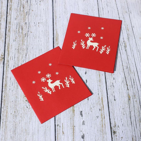 reindeer in the woods pop up card - front cover