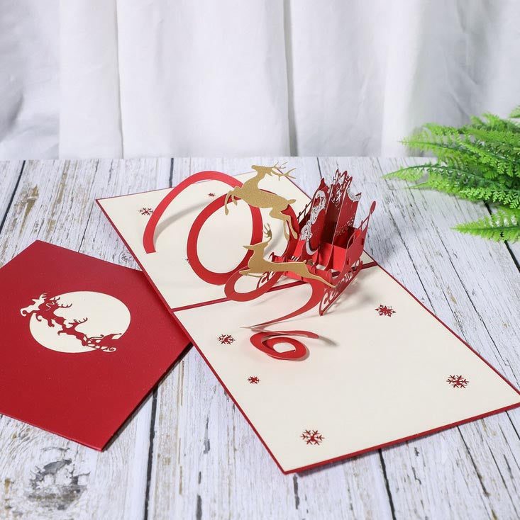 Santa in sleigh christmas pop up card opened and closed cards together