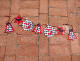 4.5ft Creepy Christmas Paper Garland in Black & Red