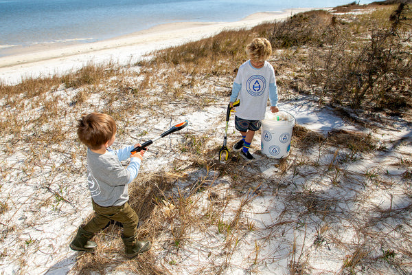 Happy day cleaning the beach