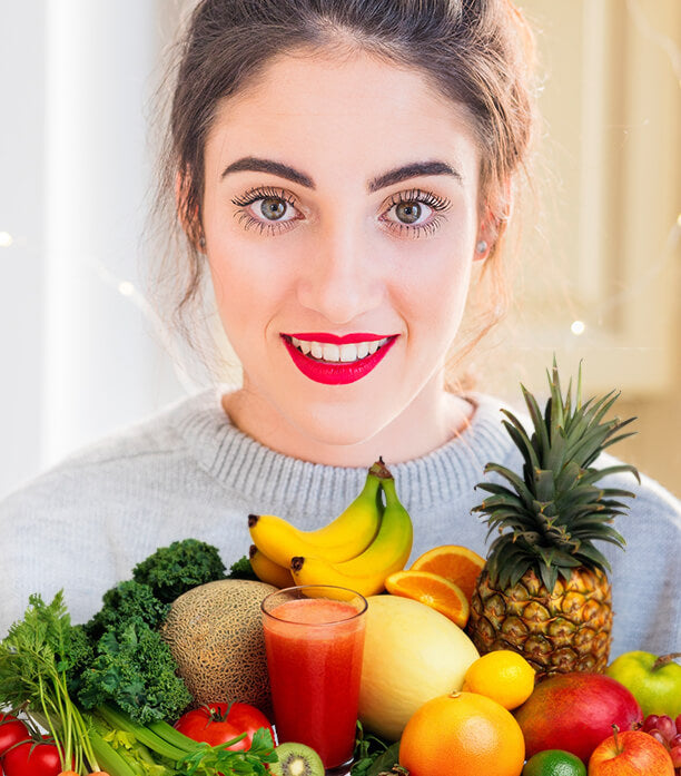 A woman and a collection of fruits and vegetables