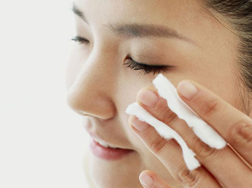 Woman using a wipe to clean her face
