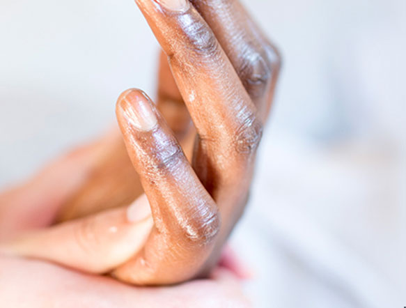 close up of a hand applying hand sanitizer