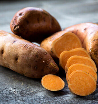 Sliced and whole sweet potatoes