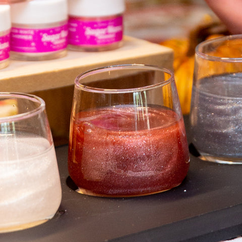 Wine flight featuring Bordeaux Babe, Sugar Mama Shimmer's maroon/burgundy edible glitter for drinks in stemless wine glass. Perfect for Texas A&M tailgates.