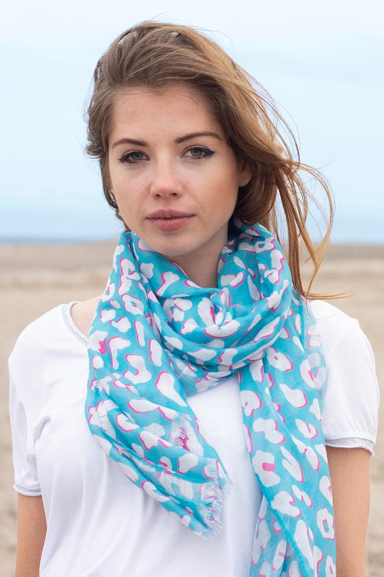 A turquoise and pink colour contrast leopard print scarf.