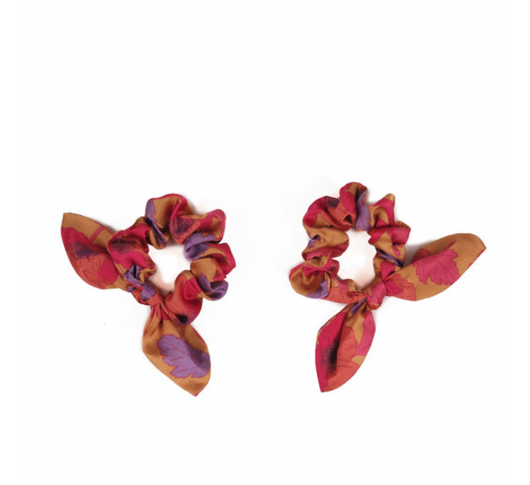 Everyone loves a scrunchie! These satin sweeties come in packs of two so you can style them loads of different ways or wear them on your wrist for those urgent hair up moments. These Poppy Bright Scrunchies add a touch of colour to even the dullest of hair days! Delivered in the cutest, teeny tiny, limited edition Powder gift bag.