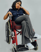 Load image into Gallery viewer, Female model in wheelchair is wearing navy blue Magnetic T-shirt, features magnetic buttons for easy wear. Adaptive clothing by Dawn Adaptive that makes dressing up easier.