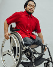 Load image into Gallery viewer, Male model in wheelchair is wearing red Magnetic T-shirt, features magnetic buttons for easy wear. Adaptive clothing by Dawn Adaptive that makes dressing up easier.