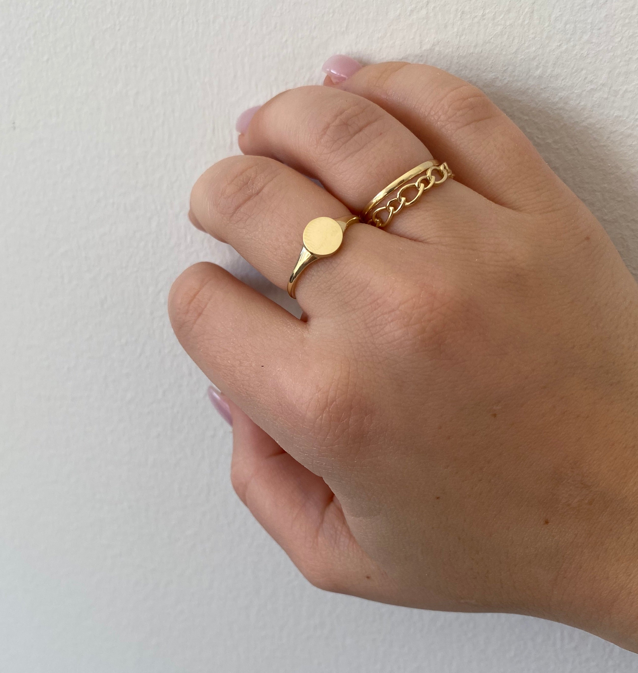hand with gold rings