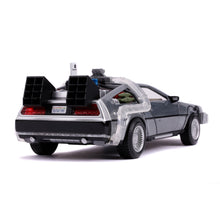 Load image into Gallery viewer, Travel back to the future with one of the most iconic vehicles in the Hollywood Rides lineup: the Time Machine as seen in Back to the Future Part II (1989). Featuring a die-cast metal body, rubber tires, opening doors, light-up feature and best of all you can fold the wheels inward and display the Time Machine in hover mode. This 1:24 scale vehicle is a must have in any collection!