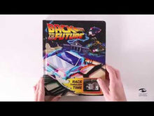 Load and play video in Gallery viewer, Back to the Future: Race Through Time Hardcover Book with Collectible Wind-up DeLorean